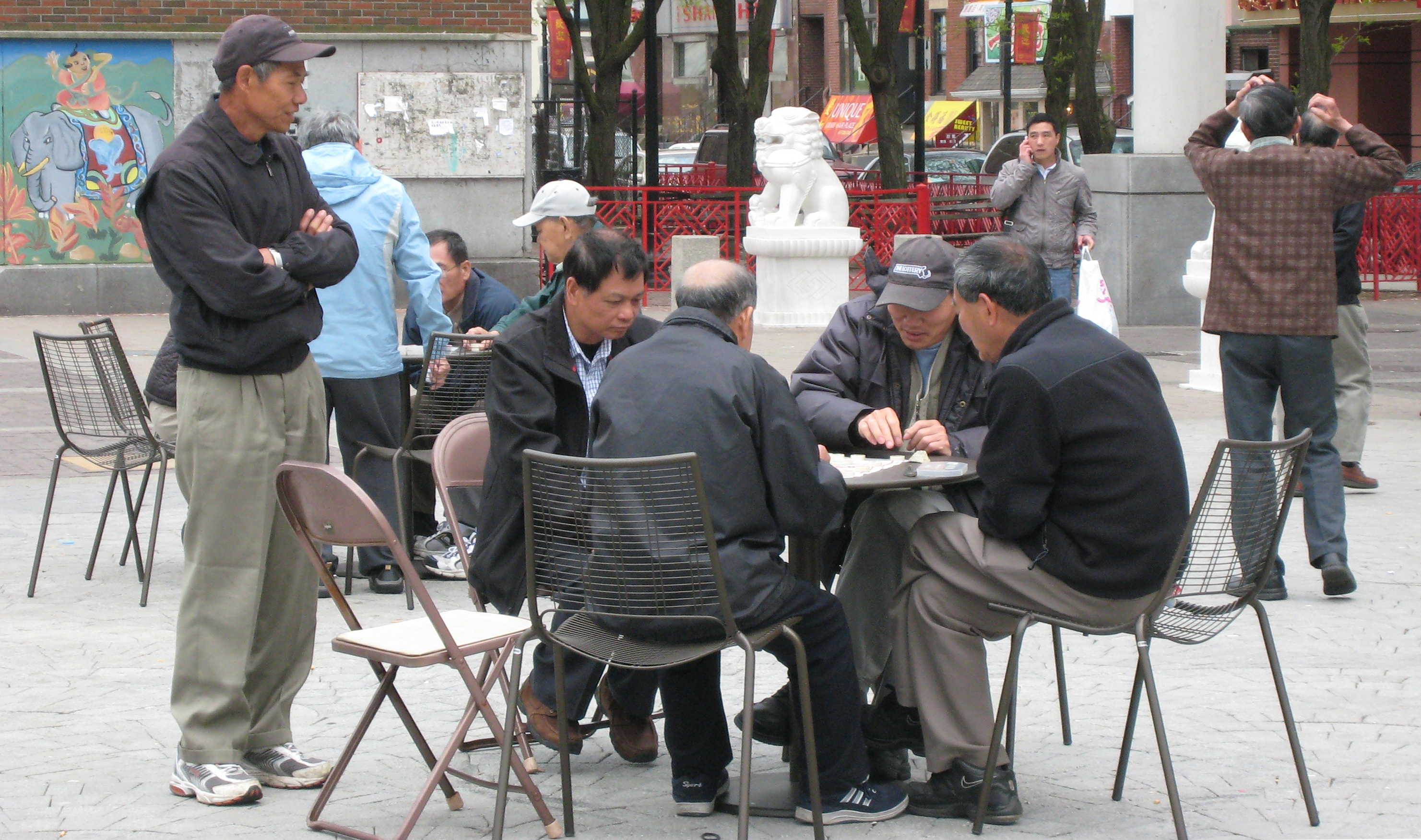 Men sitting at a table in Boston's Chinatown