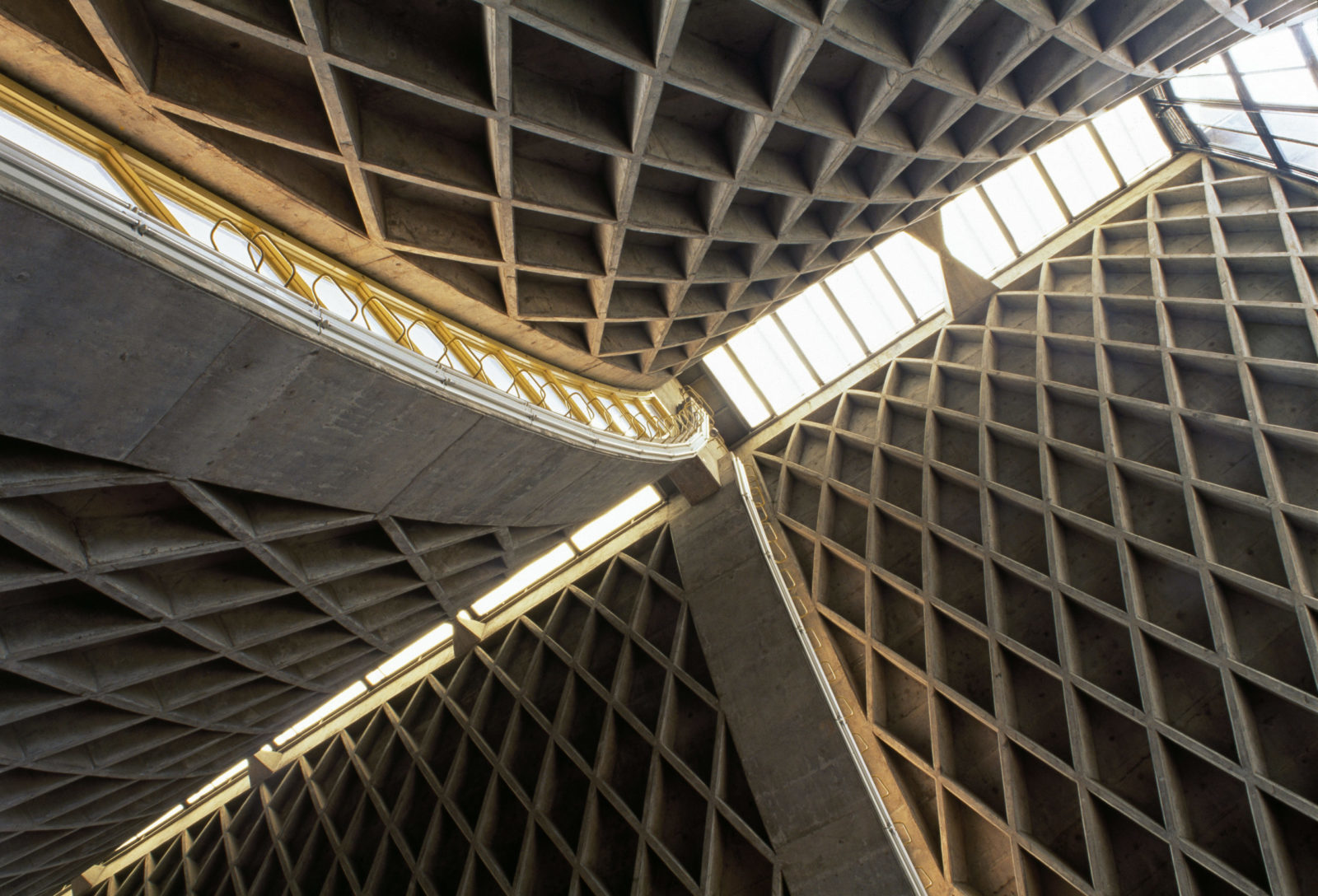 Photograph of geometric sweeping interior of IM Pei's Luce Chapel