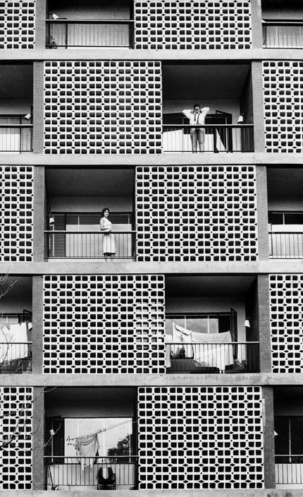 Abstract building with people on balconies