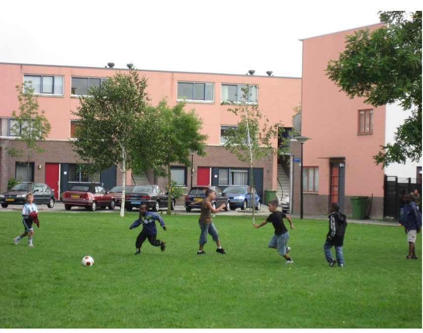 Multiracial group of young boys playing soccer in Amsterdam